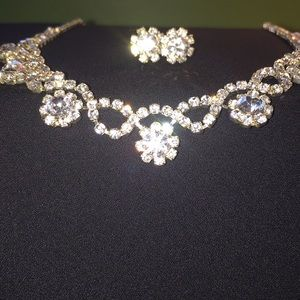 Sparkling cubic zirconia necklace and earrings.